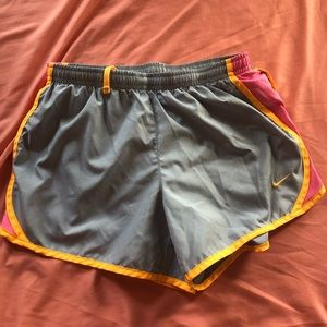 grey, yellow, and pink nike dri-fit shorts